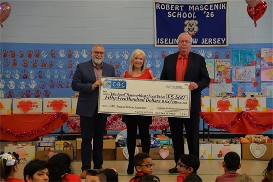 The Colonia Business Community reports to Robert Mascenik School #26 in Iselin to drop-off $5,500.00